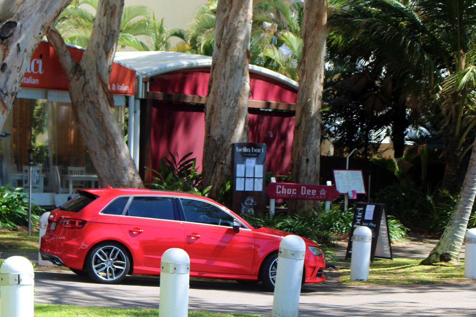 Choc Dee street view with audi s3 parked in front before opening